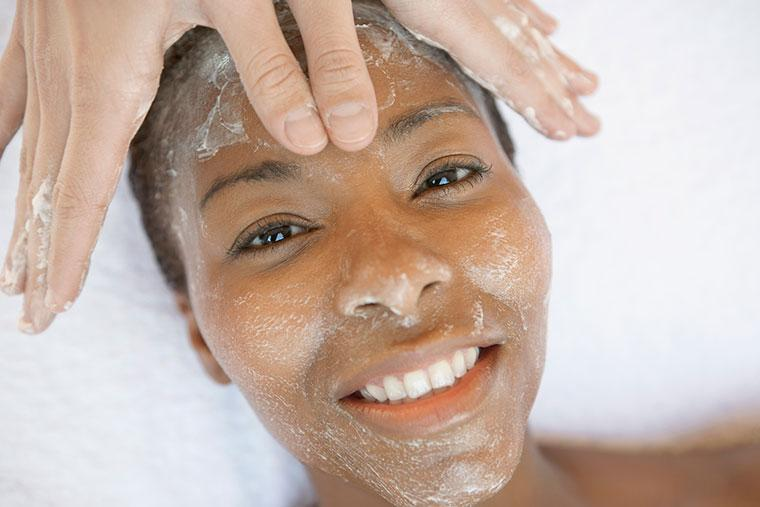 Woman getting skin exfoliated