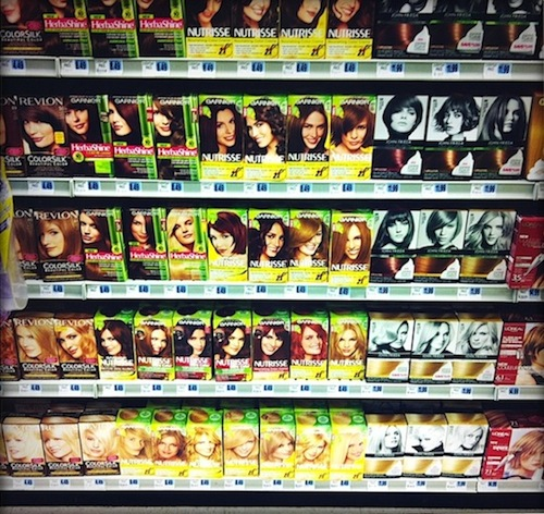 At-home hair color on drugstore shelf.